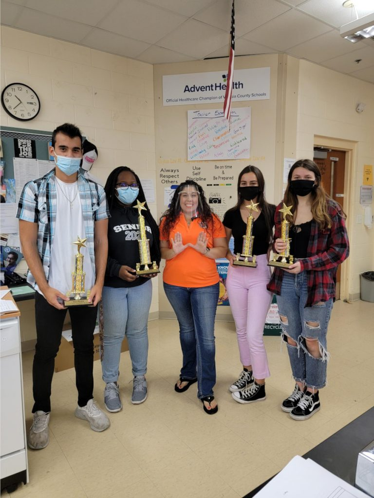 University High School winners of a virtual brain bee and their teacher, organized by Stetson University in Florida.